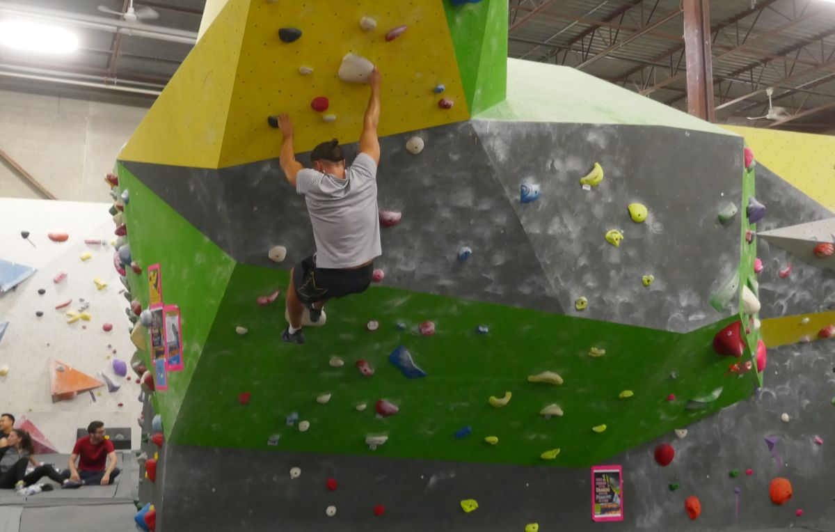 Martin finally lets go and falls into the dragon's Pit of Gold (red and yellow foam cubes) at Hub Climbing in Masrkham