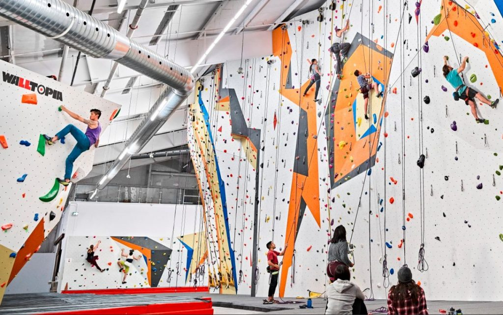 Climbers climbing around the gym