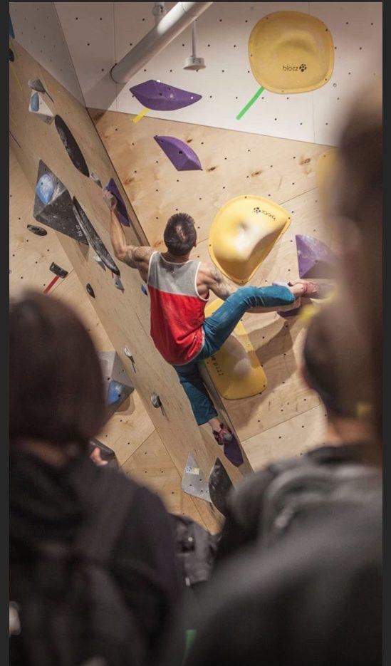 Competitor climbing at Hub MEC
