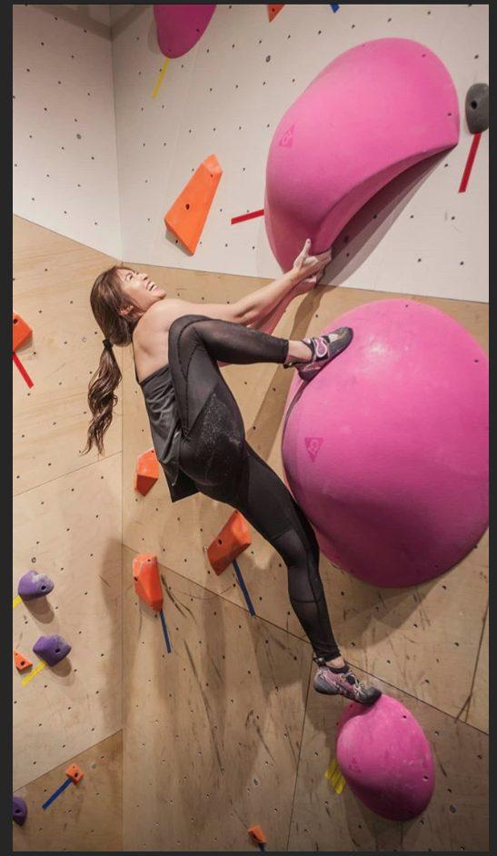 Competitor bouldering at Hub MEC